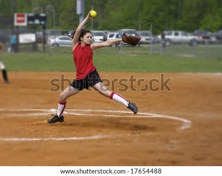 a fastpitch softball player pitching the windmill - stock photo