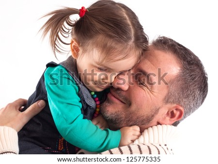 A father and a doughter together hold each other and have closed eyes. in front of white background - stock photo