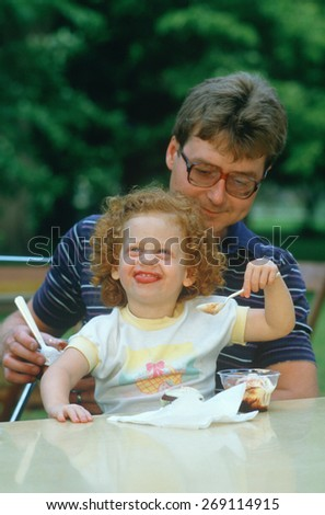 A father and daughter eating ice cream, Westfield, NY