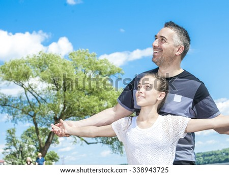 A Father and daughter having fun time outside