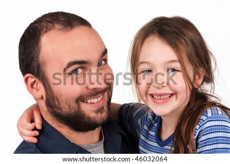 a father and daughter smiling for the camera - stock photo