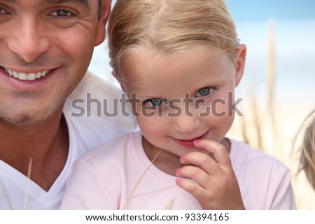 A father and his daughter at the beach. - stock photo