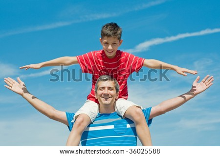 a father and his son are enjoying life outdoors