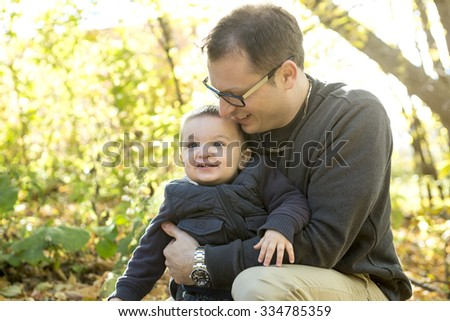 A Father and son on fall season - stock photo