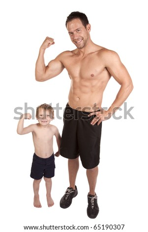A father and son showing off their muscles without shirts on flexing.