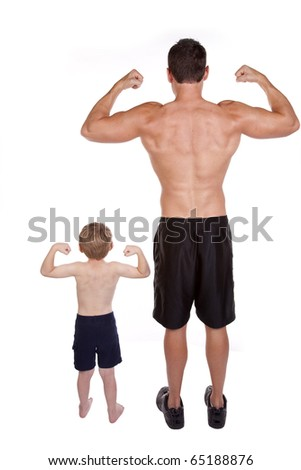 A father and son standing with their backs to the camera showing off their muscles. - stock photo