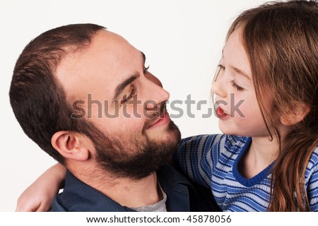 a father and young daughter having a conversation - stock photo