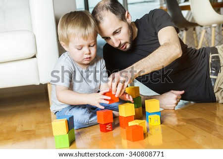 A father play block with his son at home
