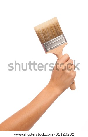 A feamle hand and arm holding a decorating brush - stock photo
