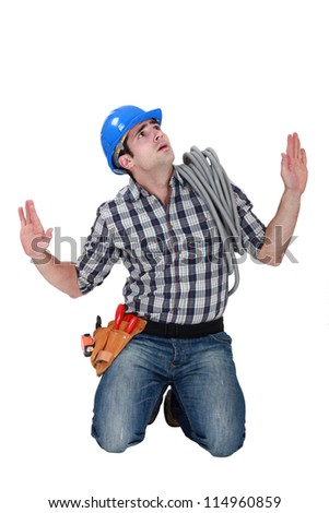 A fearful tradesman - stock photo