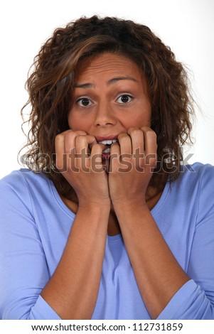 A fearful woman - stock photo