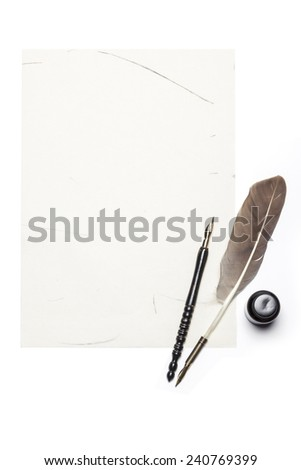 A feather quill pen, fountain pen, letter, ink isolated white at the studio. - stock photo
