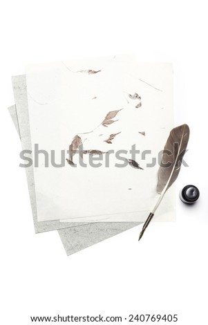 A feather quill pen, letter, ink isolated white at the studio. - stock photo