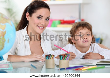 a female adult and a child girl drawing - stock photo