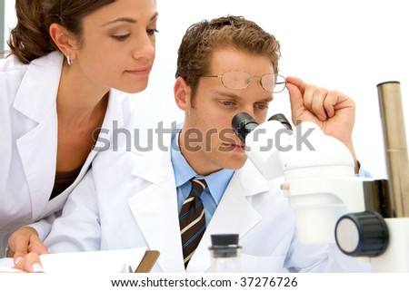 A female and male scientist working in a lab - stock photo