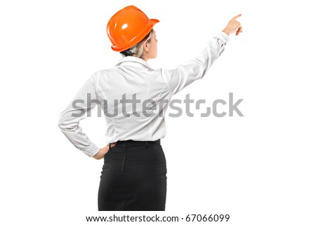 A female architect pointing isolated against white background