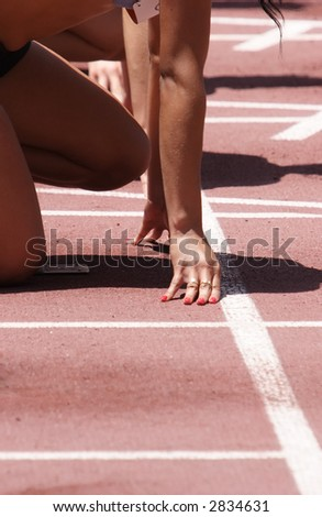 A female athlete getting ready to race