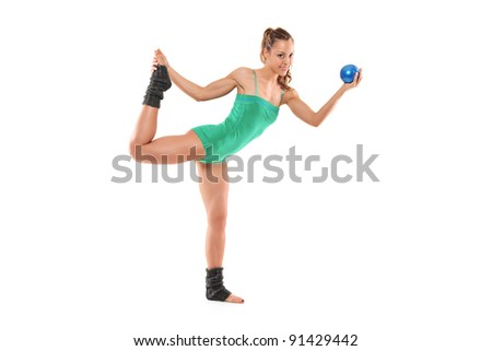 A female athlete working out with a ball isolated on white background - stock photo