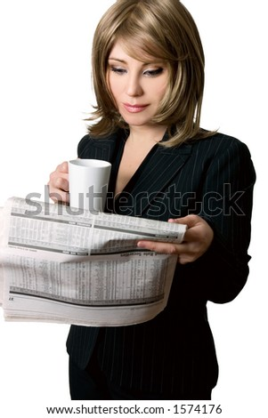 A female broker reading the days financial market information. - stock photo