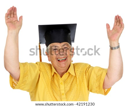 A female caucasian in yellow graduation gown and very excited. - stock photo