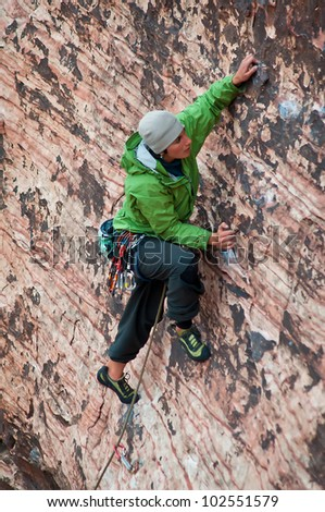 A Female Climber Scaling a Wall in Red Rocks, Nevada - stock photo