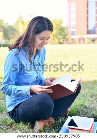 A female college student studying on campus