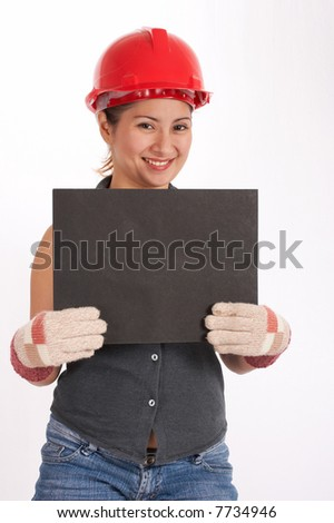 A female construction worker holding a blank board