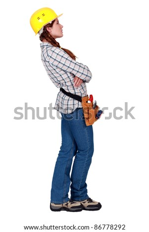 A female construction worker looking away. - stock photo