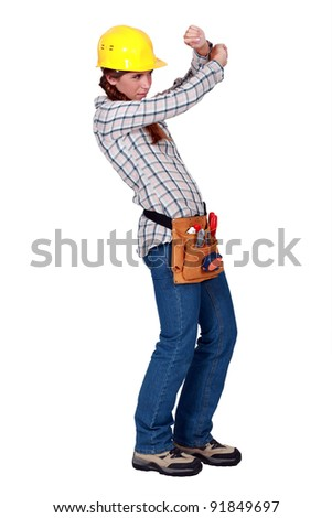 A female construction worker protecting her eyes. - stock photo