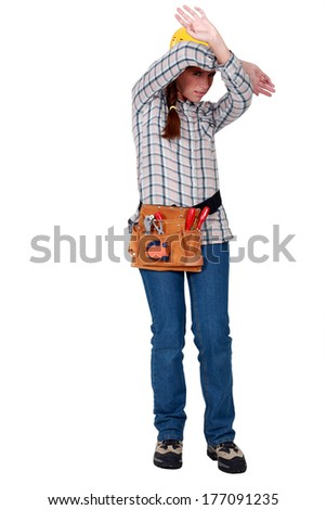 A female construction worker protecting herself. - stock photo