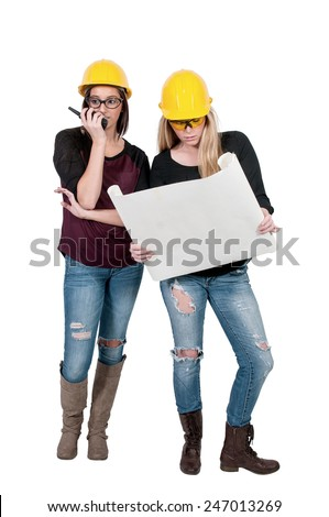 A Female Construction Worker wearing a hard hat and safety glasses - stock photo