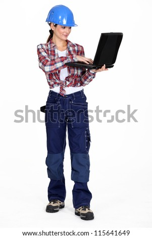 A female construction worker with a laptop.