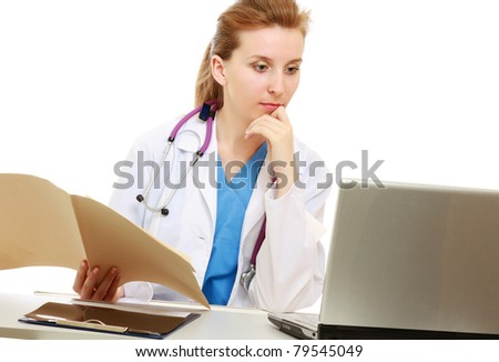 A female doctor at her workplace, isolated on white