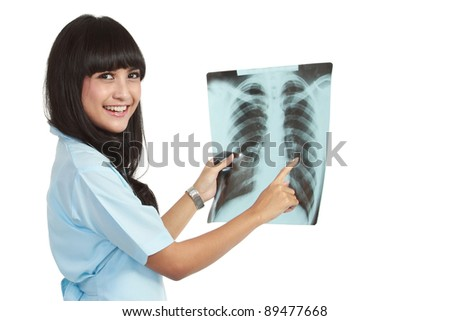 A female doctor is checking x-ray - isolated on white background - stock photo