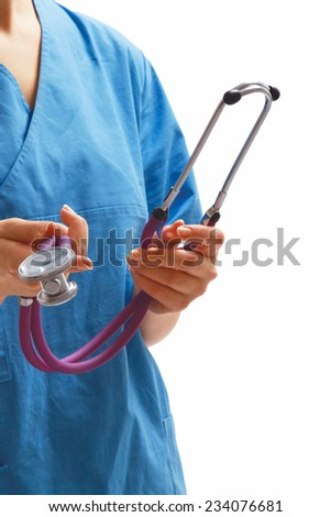 A female doctor or a nurse with a stethoscope in her hands - stock photo