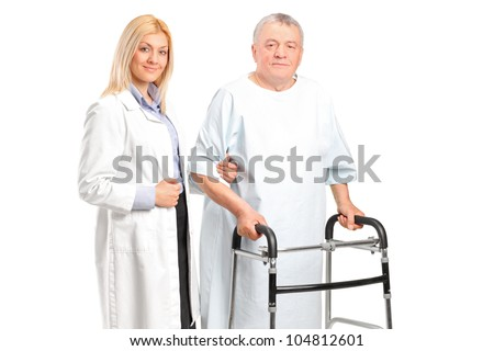A female doctor or nurse helping a senior patient to use a walker isolated on white background - stock photo