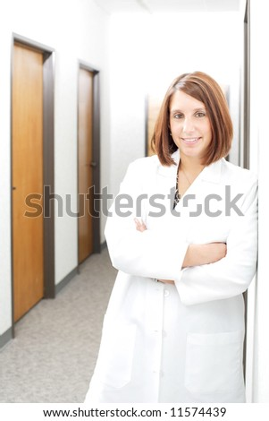 A female Doctor standing in a hallway at a hospital - stock photo