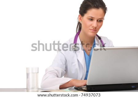 A female doctor working on the laptop - stock photo
