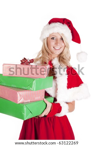A female dressed like santa holding some presents. - stock photo