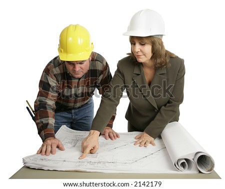 A female engineer going over the blueprints with a building contractor.  Isolated on white. - stock photo