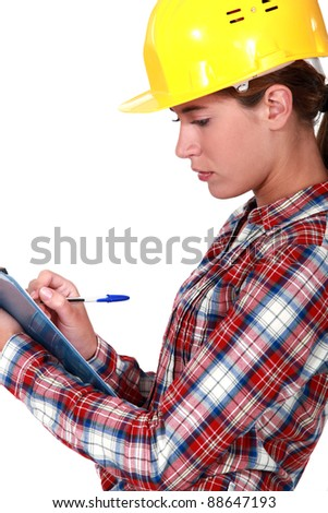 A female foreman with a clipboard.