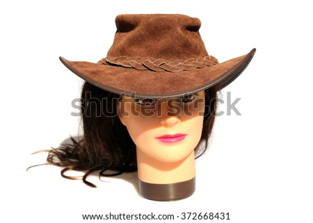 A female Hair Dressers Mannequin Head wears a leather hat.  Isolated on white with room for your text. - stock photo