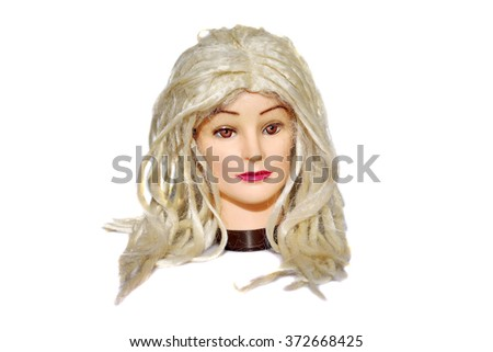 A female Hair Dressers Mannequin Head wears a Platinum blonde Wig.  Isolated on white with room for your text. - stock photo