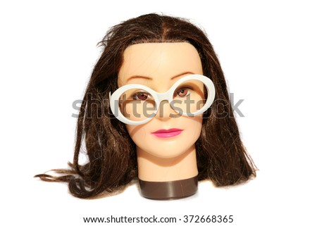 A female Hair Dressers Mannequin Head wears White Fashion Glasses.  Isolated on white with room for your text. - stock photo