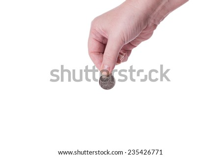 A Female Hand Holding a Coin Isolated on a White Background. - stock photo