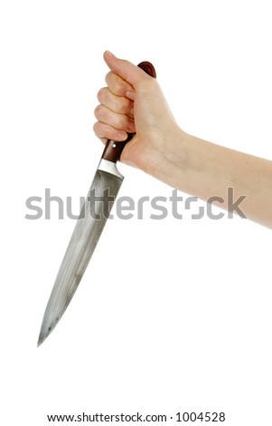 A female hand holding a large butcher  knife (in a stabbing grip)  isolated on white with clipping path.