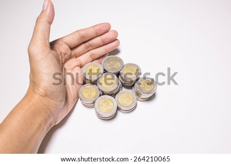 A female hand holding coins