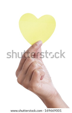 A female hand holding paper heart, isolated on white. with using path - stock photo