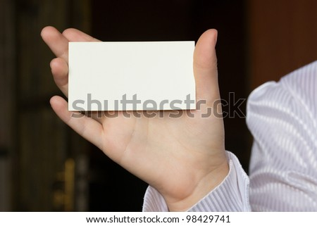 a female hand with a card - stock photo