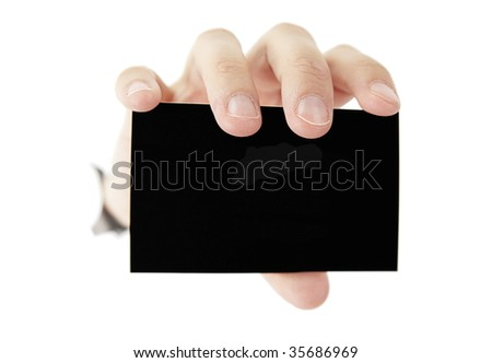 A female hande is holding a black blank business card - stock photo